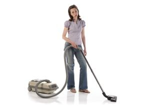 Bored woman vacuuming